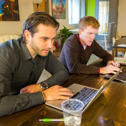Employees working in the TechTavern at TechnologyAdvice