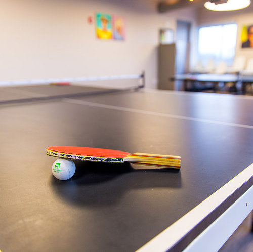 TechnologyAdvice employees enjoy ping pong competitions