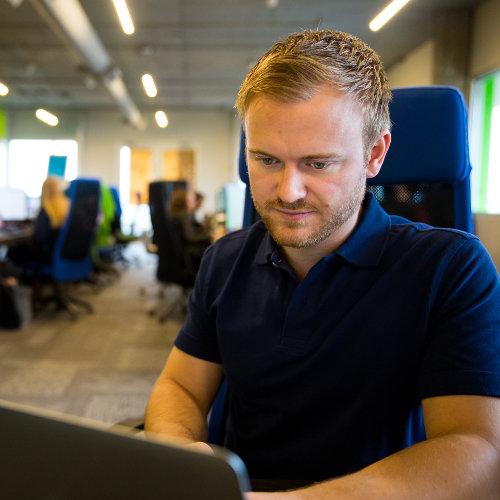 Jordan Schneider working on his laptop
