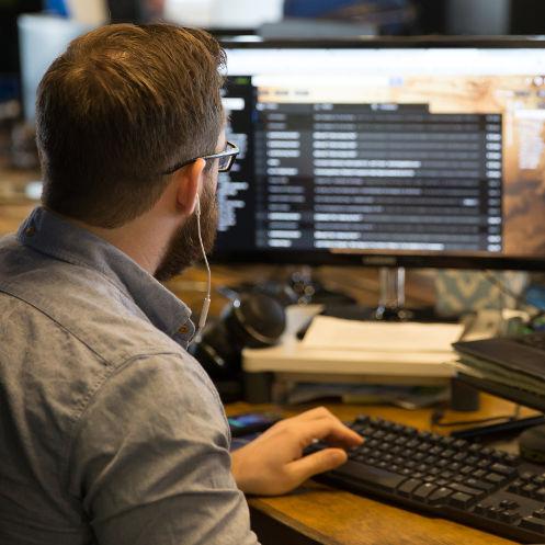 Zach Watson working at his desk