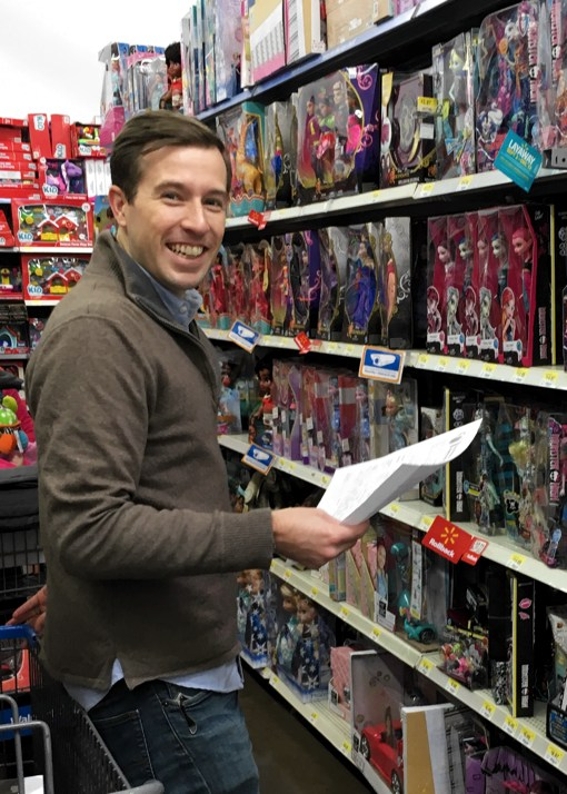 One of TechnologyAdvice's Client Success Managers shops for toys during the Youth Villages holiday heroes shopping outting