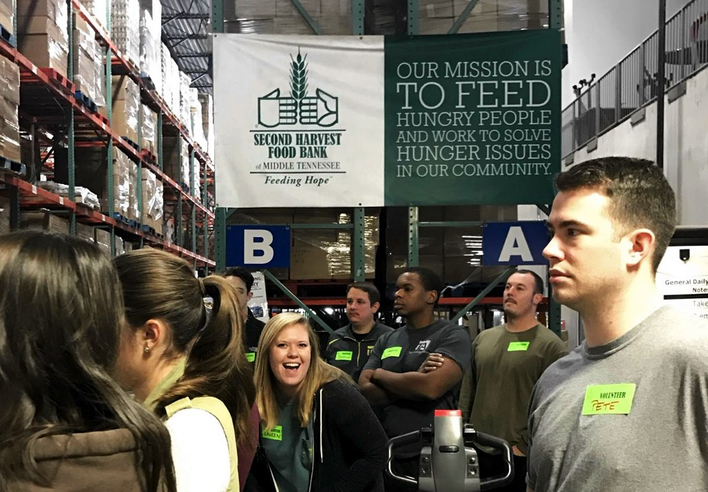 TechnologyAdvice gives back by volunteering to sort food at Second Harvest Foodbank